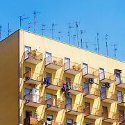 An apartment building covered with antennas in Naples, Italy.