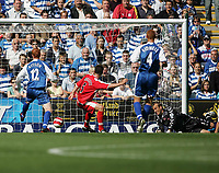 Photo: Lee Earle.<br /> Reading v Middlesbrough. The Barclays Premiership. 19/08/2006. Reading's Dave Kitson (L) slots the ball past Middlesbrough keeper Mark Schwarzer to score their first.