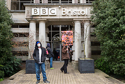 """© Licensed to London News Pictures;07/04/2021; Bristol, UK. A sixth """"Kill the Bill"""" protest takes place outside the BBC offices in Bristol against the Police, Crime, Sentencing and Courts Bill during the Covid-19 coronavirus pandemic in England. This protest is billed as """"Stand up against a police state and against a biased media"""" and the protest is due to march from College Green in the city centre to the offices of BBC Bristol on Whiteladies Road. Some protesters say that the media is biased. One person was arrested for urinating near the front door of the BBC. The Police, Crime, Sentencing and Courts Bill proposes new restrictions on protests. Some previous Kill the Bill protests in Bristol had violence. Photo credit: Simon Chapman/LNP."""