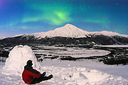Alaska , Brooks Range. Iniakuk Lake Lodge. Aurora Borealis and an illuminated igloo.