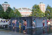 Children playing in a fountain near Navy pier's children museum. Chicago, IL, USA
