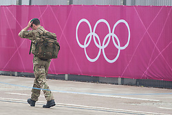 © licensed to London News Pictures. London, UK 14/07/2012. A soldier walking outside the Olympic site in Stratford today. Photo credit: Tolga Akmen/LNP