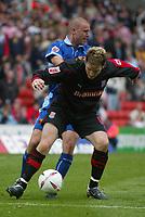 Photo: Chris Brunskill. Stoke City v Watford. Coca-Cola Championship. 30/04/2005. Chris Greenacre of Stoke holds off Danny Cullip of Watford.