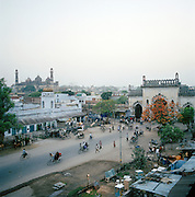 Old city gate and Great Imambara at dusk, Lucknow, Uttar Pradesh, India