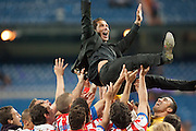 The Team toss in a blanket to Diego Pablo Simeone, atletico de Madrid's coach