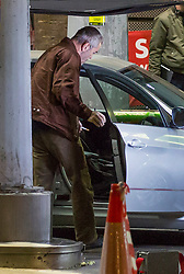 © Licensed to London News Pictures. 30/09/2021. London, UK. Actor James Nesbitt is seen getting into a car as a film crew works at a petrol station in Vauxhall, central London filming Channel 4's 'Suspect' during the seventh day of the fuel crisis. It is being reported that the Texaco petrol station which closed for the filming was fully stocked. Photo credit: Marcin Nowak/LNP