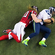 Atlanta Falcons defensive end Brooks Reed (50) sacks Seattle Seahawks quarterback Russell Wilson (3) during an NFC Divisional Playoff NFL football game on Saturday, Jan. 14, 2017 in Atlanta. The Falcons won, 36-20. (Ric Tapia via AP)