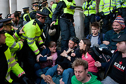 © licensed to London News Pictures. London, UK 12/05/2012. Occupy London protesters resisting against the police as they occupy the area outside the Bank of England, this evening (12/05/12). Photo credit: Tolga Akmen/LNP