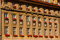 A building facade on Bundesplatz with flower window boxes, Bern, Canton Bern, Switzerland
