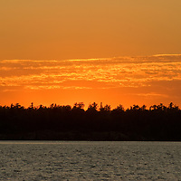 Summer sunset over Lake of the Woods, Ontario, Canada.