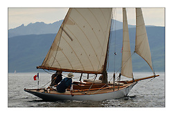 Seabird, recently built Gaff Cutter from France. The design similar to that of the late Fife enthusiast Eric Taberly. Sailing in light winds near Arran on the last day...This the largest gathering of classic yachts designed by William Fife returned to their birth place on the Clyde to participate in the 2nd Fife Regatta. 22 Yachts from around the world participated in the event which honoured the skills of Yacht Designer Wm Fife, and his yard in Fairlie, Scotland...FAO Picture Desk..Marc Turner / PFM Pictures