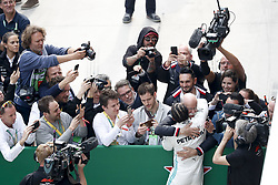 April 14, 2019 - Shanghai, China - Motorsports: FIA Formula One World Championship 2019, Grand Prix of China, ..#44 Lewis Hamilton (GBR, Mercedes AMG Petronas Motorsport), Dr. Dieter Zetsche (GER, Chairman of the Board of Management of Daimler AG, Head of Mercedes-Benz Cars) (Credit Image: © Hoch Zwei via ZUMA Wire)