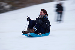 © under license to London News Pictures. 18/12/10. Sledging down the observatory slope. After heavy snowfall in London today (Sat), people take advantage of the snow in Greenwich Park. Credit should read Matt Cetti-Roberts/London News Pictures