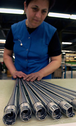 HERSTAL, BELGIUM - APRIL-11-2003 - A technician inspects a machined gun barrel to make sure it meets specifications at the FN Herstal weapons fabrication plant near Liege, Belgium. (PHOTO © JOCK FISTICK)