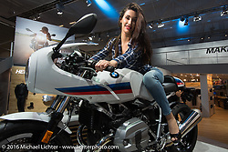 A model aboard the just released BMW Cafe Racer (on the RNine-T platform) in the BMW Motorcycles display at the Intermot Motorcycle Trade Fair. Cologne, Germany. Wednesday October 5, 2016. Photography ©2016 Michael Lichter.