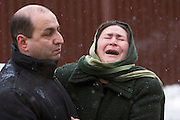 Moscow, Russia, 23/02/2006..A woman weeping outside Baumanskii Marrket in eastern Moscow after the market roof collapsed, apparently under the weight of snow, killing many people.