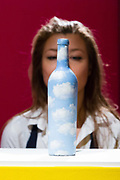 A staff member looks at Ciel-Bouteille by Rene Magritte, on February 22nd, 2018 at the preview for Sothebys upcoming Impressionist, Modern and Surrealist Art auction at Sothebys in New Bond Street, London, England.