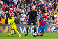 Football - 2021/2022  Premier League - Crystal Palace vs Brentford - Selhurst Park  - Saturday 21st August 2021.<br /> <br /> James McArthur (Crystal Palace) is fouled by Frank Onyeka (Brentford FC) right in front of referee Martin Atkinson<br /> at Selhurst Park.<br /> <br /> COLORSPORT/DANIEL BEARHAM
