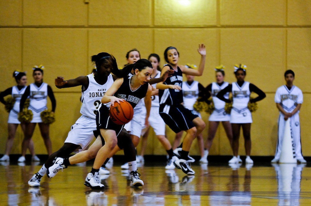 Mt. Assisi Eagle Jillian Kossifos seeks a way around St. Ignatius Guard Mariah Harris during Varsity Girls Basketball at the Joseph J. Gentile Gymnasium in Chicago. Ignatius delivered a decisive 53-21 victory. January 7, 2012 l Brian J. Morowczynski~ViaPhotos..For use in a single edition of Catholic New World Publications, Archdiocese of Chicago. Further use and/or distribution may be negotiated separately. ..Contact ViaPhotos at 708-602-0449 or email brian@viaphotos.com.