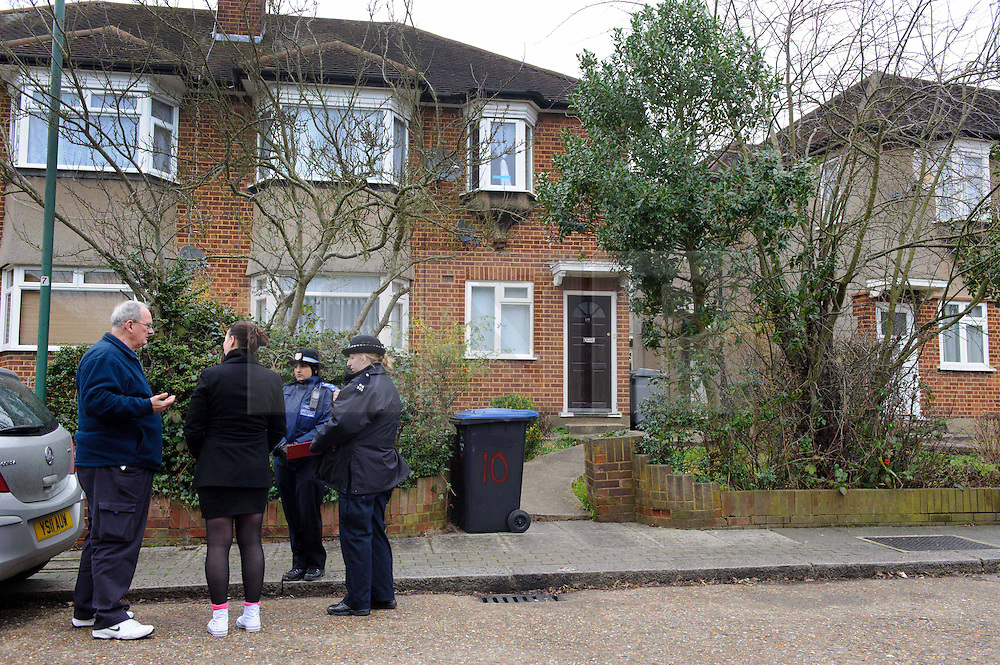 © Licensed to London News Pictures. 10/01/2014 Harrow, UK. Police officers and residents outside a ground floor flat on Woodgrange Close, Harrow where the bodies of  a 33-year-old woman, a five-year-old boy and  a seven month old boy have been found. The deaths of the two children are being treated as murder the woman's death is not being treated as suspicious at this stage. Photo credit : Simon Jacobs/LNP