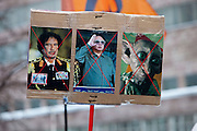 Moscow, Russia, 24/12/2011..A placard with images of the dead Libyan and North Korean leaders Gaddafi and Kim Jong Il alongside a caricature of Vladimir Putin. An estimated crowd of up to 100,000 gather for a protest against election fraud and Prime Minister Vladimir Putin in the largest anti-government demonstration in Russia since the collapse of the Soviet Union.