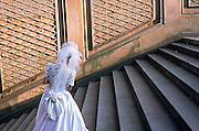 A bride standing on concrete stairs in Central Park. New York NY