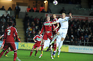 Pressure from Swansea's Gary Monk ® sees Boro's Seb Hines (c) head into his own net for the open ing goal.  Capital one cup, quarter final, Swansea city v Middlesbrough at the Liberty Stadium in Swansea, South Wales on Wednesday 12th Dec 2012. pic by Andrew Orchard, Andrew Orchard sports photography,
