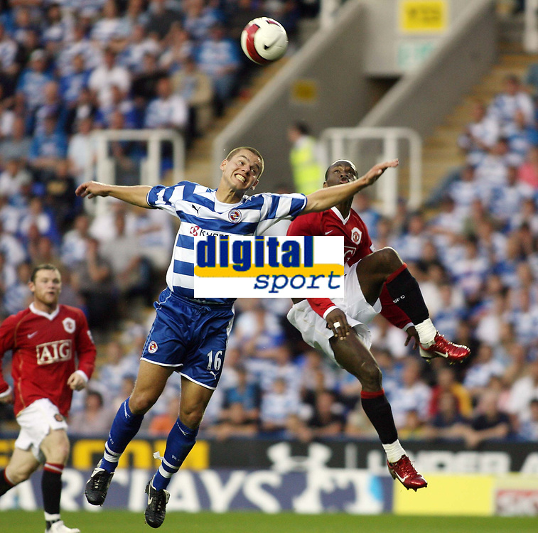 Photo: Chris Ratcliffe.<br />Reading v Manchester United. The Barclays Premiership. 23/09/2006.<br />Ivar Ingimarsson (L) of Reading clashes with Louis Saha of Man Utd.