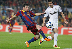 03-05-2011 VOETBAL: SEMI FINAL CL  FC BARCELONA - REAL MADRID: BARCELONA<br /> Lionel Messi and Raul Albiol<br /> *** NETHERLANDS ONLY***<br /> ©2011-FH.nl- EXPA/ Alterphotos/ Acero
