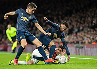 Football - 2018 / 2019 FA Cup - Fourth Round: Arsenal vs. Manchester United <br /> <br /> Lucas Torreira (Arsenal FC) battles on the ground to keep possesion from Jesse Lingard (Manchester United) at The Emirates Stadium.<br /> <br /> COLORSPORT/DANIEL BEARHAM