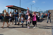 Commuters walk southwards over London Bridge, from the City of London - the capital's financial district founded by the Romans in the 1st century - to Southwark on the south bank, on 2nd August 2018, in London, England.