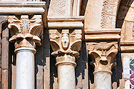 Romanesque columns and sculpted Anthropomorphic capitals of main entrance of the 8th century Romanesque Basilica church of St Peters, Tuscania, Lazio, Italy .<br /> <br /> Visit our ITALY PHOTO COLLECTION for more   photos of Italy to download or buy as prints https://funkystock.photoshelter.com/gallery-collection/2b-Pictures-Images-of-Italy-Photos-of-Italian-Historic-Landmark-Sites/C0000qxA2zGFjd_k .<br /> <br /> Visit our MEDIEVAL PHOTO COLLECTIONS for more   photos  to download or buy as prints https://funkystock.photoshelter.com/gallery-collection/Medieval-Middle-Ages-Historic-Places-Arcaeological-Sites-Pictures-Images-of/C0000B5ZA54_WD0s