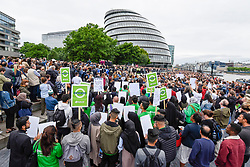 © Licensed to London News Pictures. 05/06/2017. London, UK. Large crowds gather in front of City Hall for a minute's silence and a vigil to remember the victims of the terrorist attack on London Bridge where seven people lost their lives.  Mayor of London, Sadiq Khan, gave a speech supported by religious leaders of different faiths. Photo credit : Stephen Chung/LNP