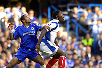 Photo: Daniel Hambury.<br />Chelsea v Portsmouth. The Barclays Premiership. 21/10/2006.<br />Chelsea's Ashley Cole is given a hard afternoon by and Portsmouth's Benjani Mwaruwari.