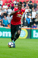 Football - 2017 / 2018 Premier League - Swansea City vs. Manchester United<br /> <br /> Paul Pogba of Manchester United on the ball—<br /> , at Liberty Stadium.<br /> <br /> COLORSPORT/WINSTON BYNORTH