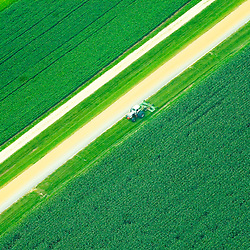 aerial view of tractor plowing farm in Pennsylvania