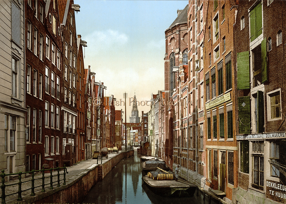 Oude Zÿds, the Kolk , Amsterdam, Holland, 1890-1900.  View of canal in the old Jewish quarter, with flat-bottomed punts or barges on the water and hand carts on the pavement. Netherlands Transport Architecture