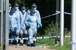 © Licensed to London News Pictures 21/09/2021. <br /> Kidbrooke, UK, Police search teams in forensic suits  at the scene. A Large police cordon is still in place around Cator Park at Kidbrooke Village in Kidbrooke, South East London today after the body of 28 year old school teacher Sabina Nessa was found near a community centre. Police believe Sabina was murdered by a stranger. Photo credit:Grant Falvey/LNP