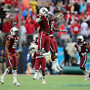 South Carolina Gamecocks linebacker Sharrod Golightly (9) celebrates during the NCAA Capital One Bowl football game between the South Carolina Gamecocks who represent the SEC and the Wisconsin Badgers who represent the Big 10 Conference, at the Florida Citrus Bowl on Wednesday, January 1, 2014 in Orlando, Florida. (AP Photo/Alex Menendez)