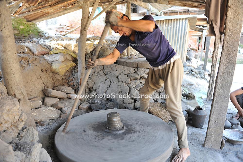 Asia, Nepal, Kathmandu, A potter and his turning wheel