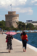 The White Tower. Walking along the seafront. Two women walking. Thessaloniki, Macedonia, Greece