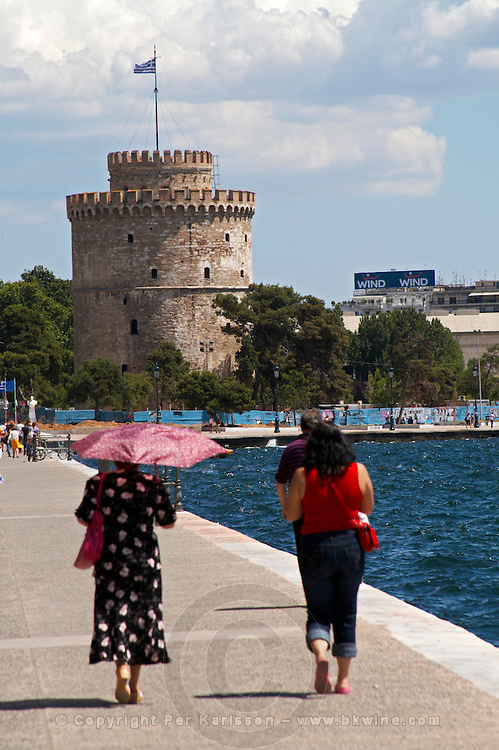 The White Tower. Walking along the seafront. Two women walking. Thessaloniki, Macedonia, Greece