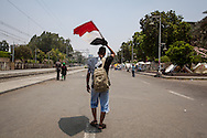 A man waves the Egyptian flag as he walks past the presidential palace in Cairo.