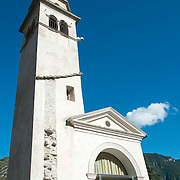 LONGARONE, ITALY - SEPTEMBER 26:  The bell tower of Pirago survived the Vajont landslide and became an iconic image of the tragedy is on  September 26, 2013 in Longarone, Italy. The Vajont  tragedy happened on the night of the 9th October 1963, when a landslide broke away from Mount Toc and fell into the Vajont river causing a wave that struck the neighboring towns, the devastation was total, more than 2000 people died and only few lucky villagers survived.  (Photo by Marco Secchi/Getty Images)