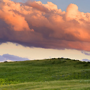Low hanging thunderstorm clouds clear at sunset over Horse Mountain Ranch in Wolcott, Colorado.