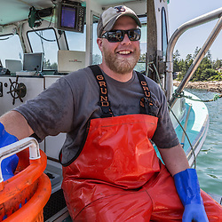 Captain Cole Baines aboard 'Jackpot' at the Spruce Head Fisherman's Co-op in South Thomaston, Maine.