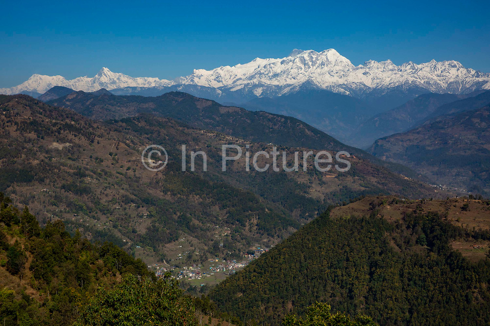 The Mansiri Himal mountain range and Himalchuli mountain acorss the valley on the 6th of March 2020 in the Mansiri Hilam subrange of the Himalayas in North Central Nepal.  Himalchuli is the second highest mountain in the Mansiri Himal, part of the Nepalese Himalayas. Himalchuli has three main peaks: East, West and North.