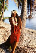Polynesin woman with lei and apreau, Ranigiroa, French Polynesia