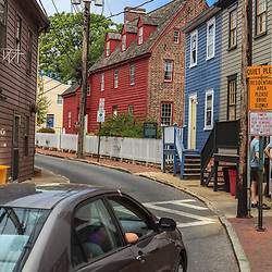 Annapolis, MD, USA - May 20, 2012: A narrow residential street with colorful houses in Annapolis Maryland.