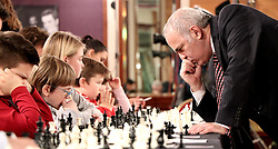 ZAGREB, Dec. 30, 2017 Russian chess grandmaster and former world champion Garry Kasparov (R) plays against children during a simultaneous chess exhibition match in Zagreb, Croatia, on Dec. 29, 2017. (Credit Image: © Relja Dusek/Xinhua via ZUMA Wire)